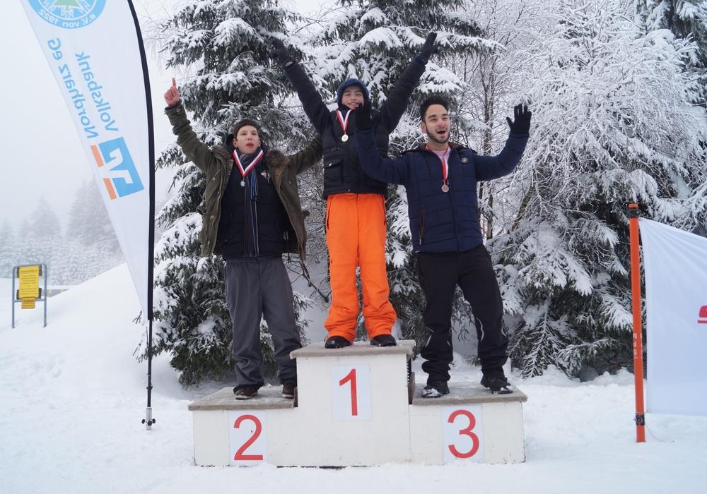 Die glücklichen Gewinner auf der Siegertreppe. Foto: Special Olympics e.V.