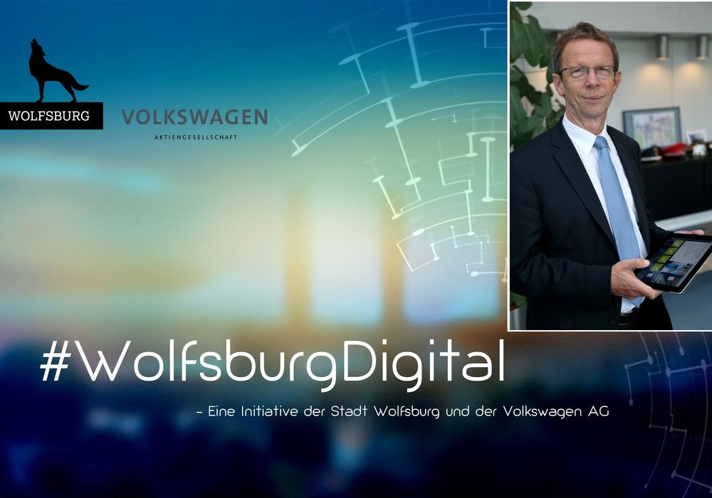 Oberbürgermeister Klaus Mohrs steht der Digitalisierung mit Tablet gegenüber. Foto: Stadt Wolfsburg.