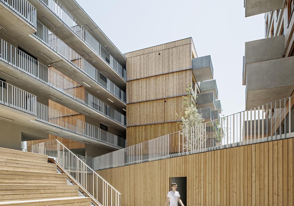 Holzwohnbau in der Wiener Seestadt Aspern. Entwurf: Berger + Parkinnen Architekten mit querkraft architekten, Wien. Foto: Hertha Hurnaus/Stadt Wolfsburg